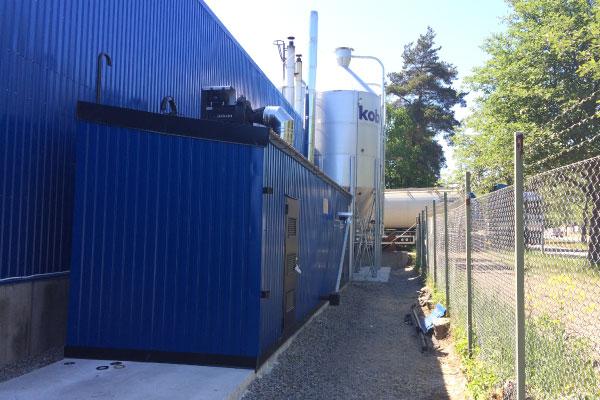 Fristående panncentral med 750 kW ångpanna samt silo hos Kobia i Tyresö.
