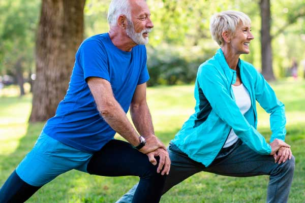 older couple training in park